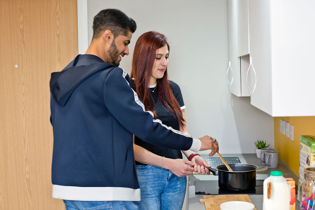 Liverpool students cooking together One Islington Plaza