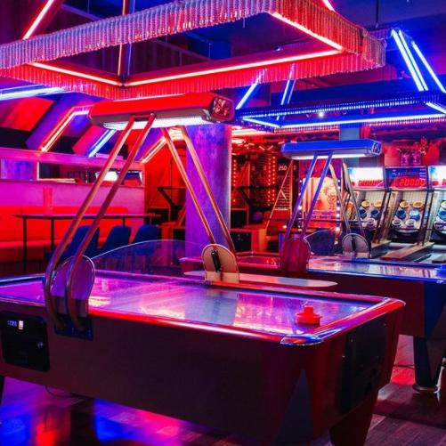 seaside arcade theme bar with ice hockey tables